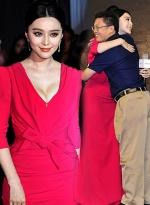 范冰冰穿低胸红裙秀半球 遭壮汉搂纤腰露甜笑